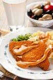 Wiener Schnitzels with sauce. Plate of Wiener Schnitzels with sauce and olives Stock Image