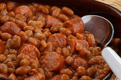 Wieners and beans. Grilled wieners and baked beans closeup Stock Photography
