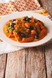 Wieprzowina gulasz w korzennym kumberlandzie wino, pomidory i śmietanka z oliv, Fotografia Royalty Free