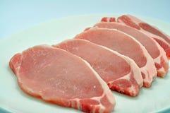 Wieprzowina kotleciki z bławym tłem obrazy stock
