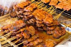 wieprzowina na grillu z płomieniem / Uliczny jedzenie w Tajlandia / tajlandzki zdjęcie stock