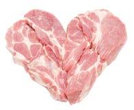 Wieprzowiny mięso w serce formie odizolowywającej na bielu Zdjęcia Royalty Free