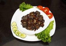 Wieprzowiny wątróbka stewed z cebulami i fasolami marchwianymi i czerwonymi Fotografia Royalty Free