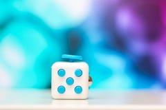 Wiercipięta sześcianu stresu anta zabawka Szczegół palcowa sztuki zabawka używać dla relaksuje Gadżet umieszczający na kolorowym  Fotografia Royalty Free