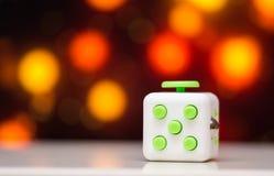 Wiercipięta sześcianu stresu anta zabawka Szczegół palcowa sztuki zabawka używać dla relaksuje Gadżet umieszczający na kolorowym  Obraz Royalty Free