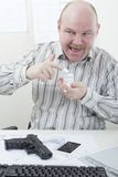 Wierd Businessman with Cocaine and Gun Stock Images