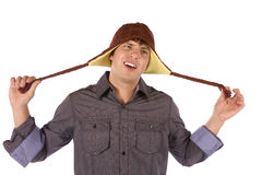 Wierd and confused. A man holding on to his hat with a really confused and crazy look on his face Royalty Free Stock Photos