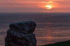 Wierzchołek Lange Anna zmierzchu Helgoland spokojny morze Zdjęcie Royalty Free