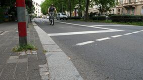 Bicycle lane and road users on a street in the city center of Wiesbaden