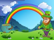 Wiese mit Regenbogen und Kobold Lizenzfreie Stockfotografie