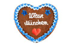 Wiesn Muenchen Oktoberfest Gingerbread heart with white isolated. German Wiesn Muenchen Oktoberfest Gingerbread heart eng. Meadow Munich October festival with royalty free stock photo