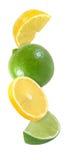 Wieszający, spadać, latający kawałek cytryny i wapna owoc odizolowywać Zdjęcia Royalty Free