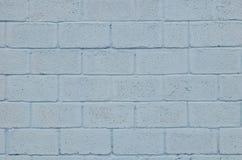 Wietrzejąca i plamiąca barwiona błękita bloku ściany tekstura Obraz Stock