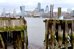 Wiev on London City from a dock. Wiev on London City from an old dock when the tide is low royalty free stock photo