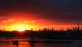 Colorful red sunrise, daylight, at the port of Corpus Christi, USA royalty free stock photo