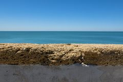 Wiew of the atlantic ocean. Landscape of the sea behind a wall Royalty Free Stock Photo