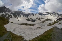 A wiew of Fagaras mountains at Balea lake in Transylvania Romania eastern Europe. Royalty Free Stock Images