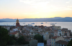Wiew of Saint-tropez old town on the sunset sky background. Beautiful weiw from citadel to old town of Saint-tropez with Notre-Dame de l'Assomption at sunset Royalty Free Stock Photography