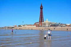 Wiew from the sea on the beach and Blackpool Tower. This photo was taken in the city Blackpool in July 2017 Stock Photos