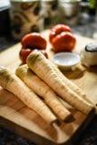 Świezi pasternaki i pomidory Zdjęcie Royalty Free