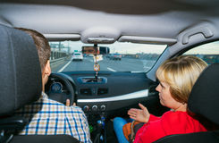 The wife argues with her husband in  car while driving. Royalty Free Stock Photography