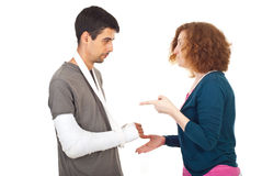 Wife arguing injured husband Royalty Free Stock Photography
