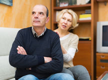 Wife asking husband for forgiveness. Guilty mature wife asking husband for forgiveness stock image