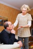 Wife asking husband for forgiveness. Guilty senior wife asking husband for forgiveness stock photo