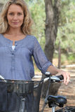 Wife with bicycle Stock Photography