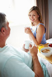 Wife Bringing Husband Breakfast In Bed On Tray Stock Photo