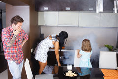 Wife burned food in the oven Stock Photo