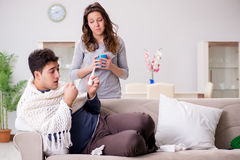 The wife caring for sick husband at home Stock Photo