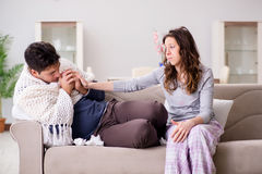 The wife caring for sick husband at home Royalty Free Stock Image