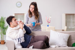 The wife caring for sick husband at home Royalty Free Stock Photo