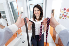 Wife choosing a tie for man Royalty Free Stock Photos