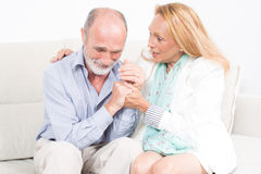 Wife comforting his husband Royalty Free Stock Images