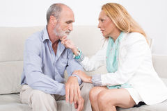 Wife comforting his husband Stock Photography