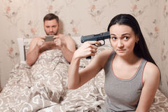 Wife commit suicide because of husband use phone Stock Photography