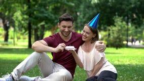 Wife congratulating husband on birthday or wedding anniversary, having fun. Stock photo royalty free stock images