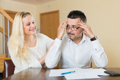 Wife consoling anxious husband Stock Photo