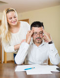 Wife consoling anxious husband Stock Photos