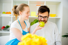 Wife cooking for husband Royalty Free Stock Images