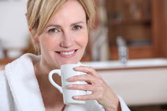 Wife with cup of tea. Wife having a cup of tea Stock Photography