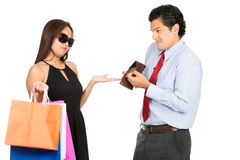 Wife Demanding No Money Poor Husband Shopping H. A greedy shopaholic gold digger stylish Asian wife demanding money for shopping from her poor sympathetic Royalty Free Stock Photos