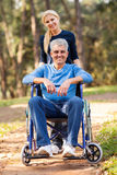Wife disabled husband Royalty Free Stock Image
