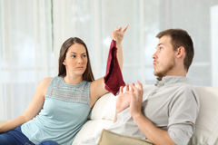 Wife discovers that her husband is cheating Stock Image