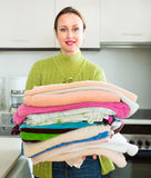 Wife doing laundry Royalty Free Stock Images