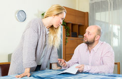 Wife explains how to fill in forms Stock Photography