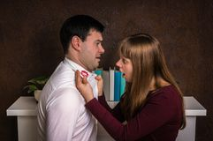 Wife finded red lipstick on shirt collar - infidelity concept. Wife finded red lipstick on shirt collar of her unfaithful husband - infidelity concept Stock Photos