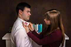 Wife finded red lipstick on shirt collar - infidelity concept. Wife finded red lipstick on shirt collar of her unfaithful husband - infidelity concept Stock Image